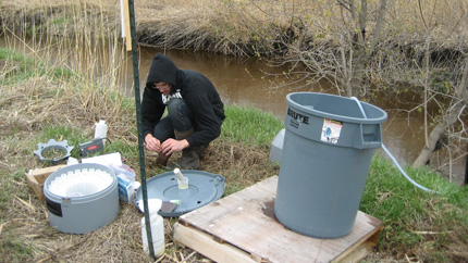 Preparing water samples after a rainfall.
