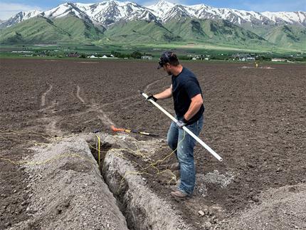 Man installing soil moisture sensors.